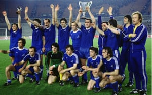 The Dinamo Tbilisi team celebrate with the European Cup Winner trophy.
