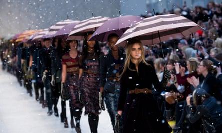Cara Delevingne and models walk the runway during the Burberry Prorsum show at London fashion week at Kensington Gardens.