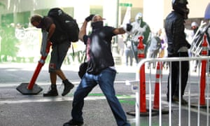 A counterprotester throws an object towards police in Portland.