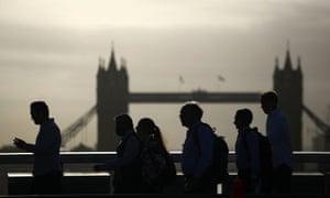 Commuters in London crossing London Bridge this morning.