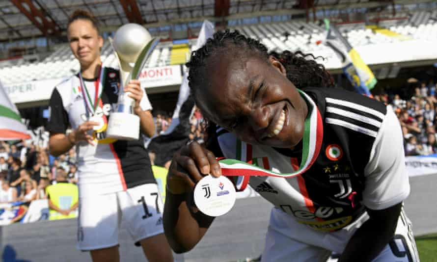 Eni Aluko shows off her medal after Juventus's victory in the Italian Supercup.