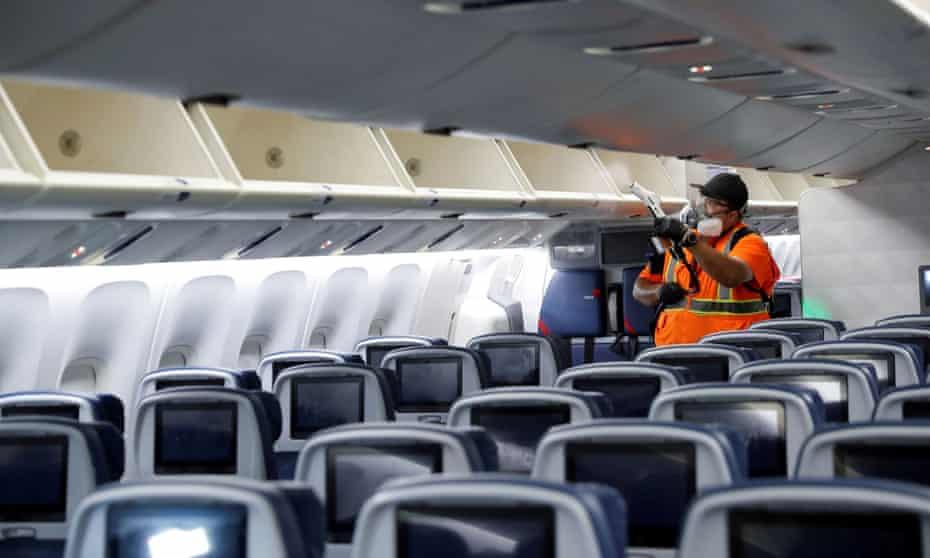 Cleaner at work inside passenger jet