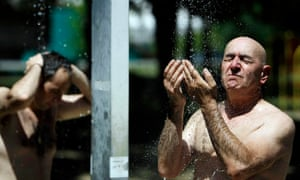 A man takes a cold shower at the Ada Ciganlija lake in Belgrade, Serbia