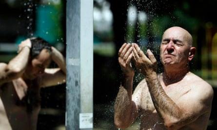 A man takes a cold shower at the Ada Ciganlija lake in Belgrade, Serbia
