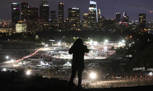 Mass Vaccinations as California Passes 3 Million. A person takes a photo of a mass Covid-19 vaccination site at Dodger Stadium, with the downtown skyline in the background, on January 22, 2021 in Los Angeles, California. California has become the first state in the nation to record 3 million known coronavirus infections.