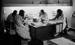 Women work in an office during a power cut