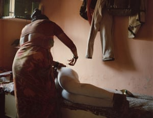 Padma gives a hormone injection, as part of a therapy to get the women ready to have embryos implanted, to one of her patients at her home in Ulhasnagar