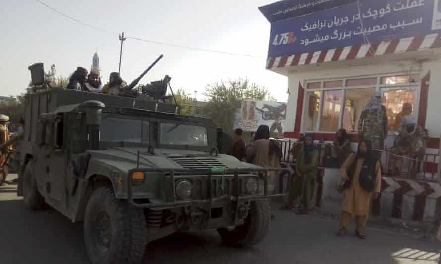 Taliban fighters guard a checkpoint in northern Afghanistan