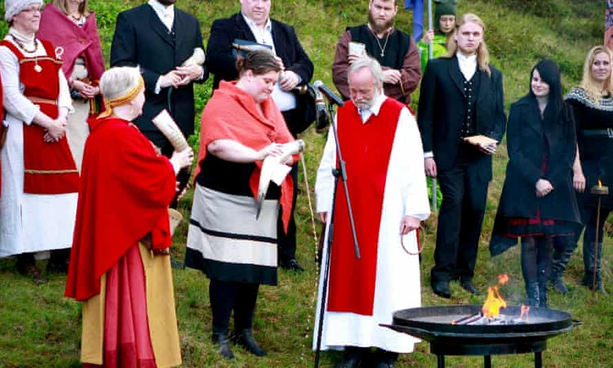 High priest Hilmar Orn Hilmarsson and fellow members of the Asatru Association attend a ceremony at the Pingvellir National Park near Reykjavik.