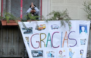 A banner hangs from the balcony of a house in Barcelona, Spain