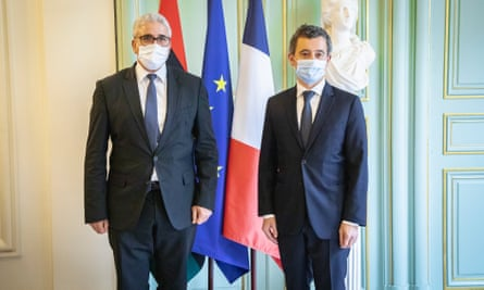 Fathi Bashagha, Libya's interior minister, left, poses with his French counterpart, Gérald Darmanin, during a visit to Paris.