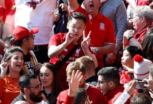 May 12: Liverpool fans react to false rumours about the score at Manchester City while watching their side face Wolves on the final day.