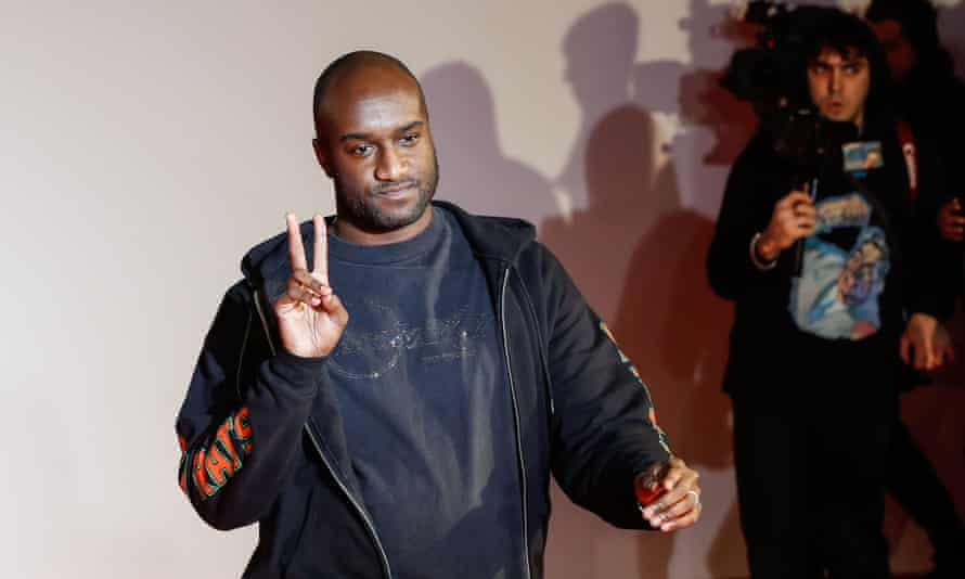 Virgil Abloh acknowledges applause at the men's fall/winter 2018/19 collection he designed for Off White in Paris