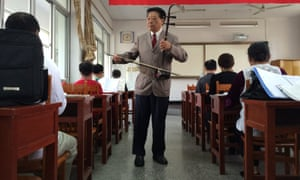 Ge Fangping, a 72-year-old music teacher, leads a class with his erhu, a Chinese fiddle.
