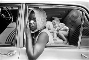 A young black girl looks after a baby girl for a white family, South Africa, 1969