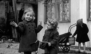 Children in front of a new prefabricated home in 1947.