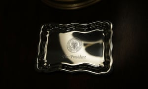 A tray engraved with the presidential seal is placed on a stand in the West Wing lobby