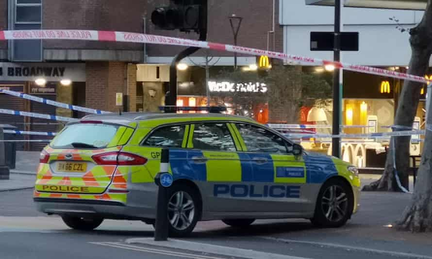 A police car and cordon outside McDonald's in Stratford, east London, following the fatal stabbing.