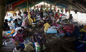 Families rest at a temporary shelter in Pimaga, Papua New Guinea, after powerful earthquakes.