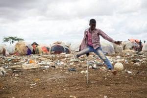 Baidoa, Somalia: Mohammed, 13, plays football
