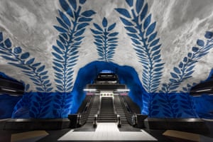 Painted blue vines climbing up a white cave in the T-Centralen metro station, Sweden.