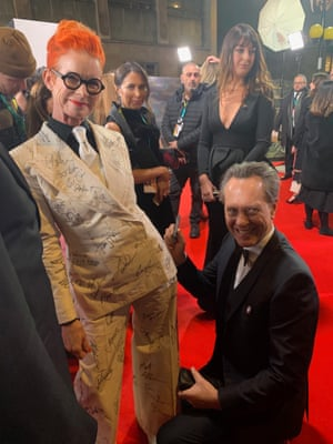 Powell with Richard E Grant.