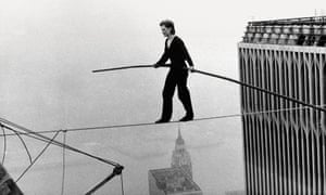 Photograph of Philippe Petit walking tightrope between Twin Towers