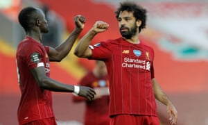 Liverpool's Mohamed Salah (right) celebrates his goal with Sadio Mane.