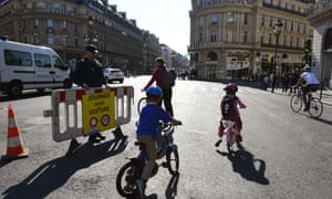 Cyclists at Place de l'Opera enjoy the 'car-free day'.