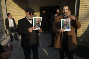 Supporters hold posters of Mohammad Baqer Qalibaf at a campaign meeting in Tehran