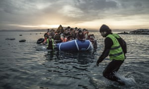 a boat filled with refugees reaches the shore of the small Greek island of Lesbos.