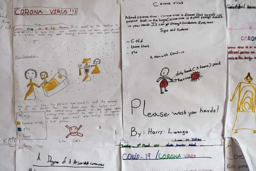 Drawings about the coronavirus on the walls of Clarke Elementary School in Kampala last April.  The drawings were made by the students just before the schools closed.