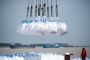Workers unloading bags of chemicals at a port in Zhangjiagang in China's eastern Jiangsu province.