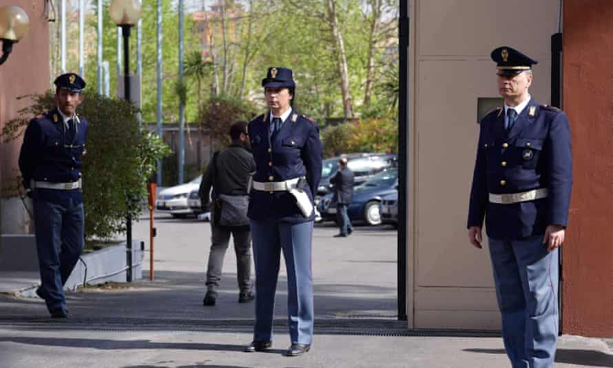 Police stand guard outside the main gate of a police station in Rome, where talks over the investigation into the death of Giulio Regeni are taking place.