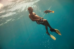 Ioanis Mihkel, a spear gun fisherman from Enipein Village, Pohnpei, prowls the water looking for and catching reef fish on the ocean side of the Enipein reef crest