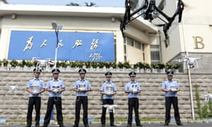 The fake inspector Lei passed himself off as a policeman for at least two years. Here, real Chinese policemen practice controlling drones after a ceremony marking the setting up of a drone squad.