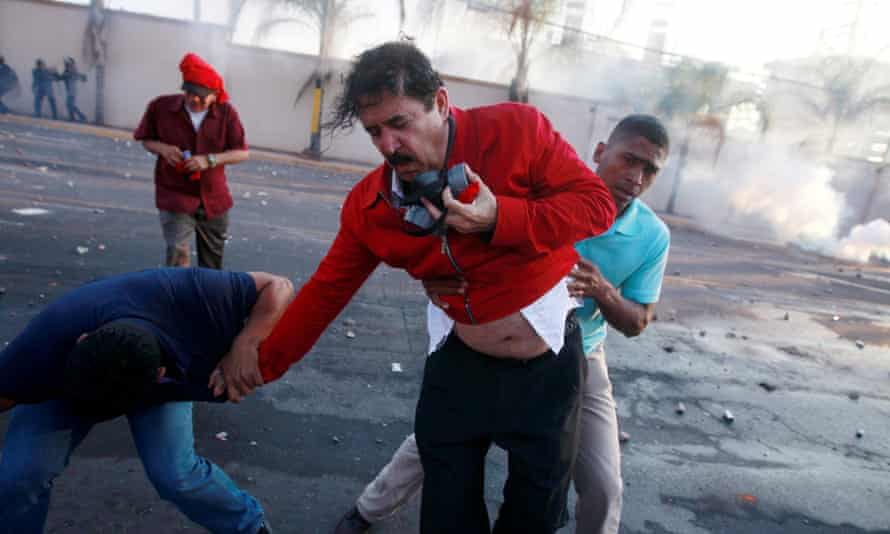 Manuel Zelaya is overcome by tear gas during a protest against the re-election of Honduras President Juan Orlando Hernández in Tegucigalpa January 2018.