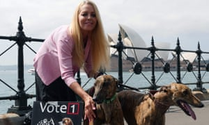 Australian animal rights activist Lynda Stoner with greyhounds at Sydney harbour. NSW will ban greyhound racing in 2017, meaning lots of dogs will need new homes.