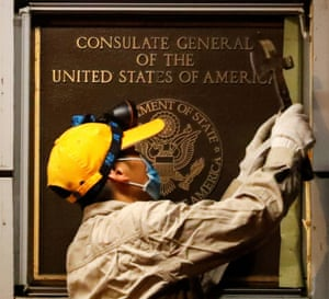 A man removes the US consulate plaque in Chengdu, Sichuan province