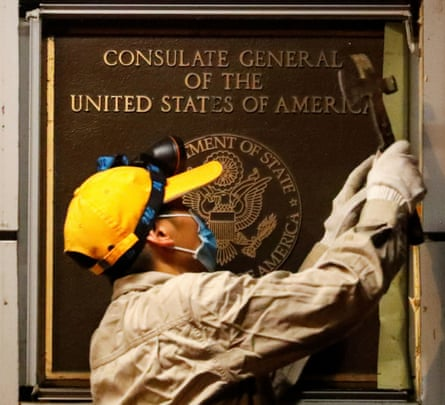 A man works to remove the US consulate plaque in Chengdu, Sichuan province.