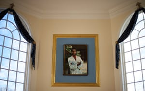 A painting of Ben Carson hangs over the fireplace in the main lounge area