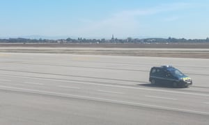 A French gendarmes vehicle speeds on the tarmac of Lyon's Saint-Exupery airport on Monday.