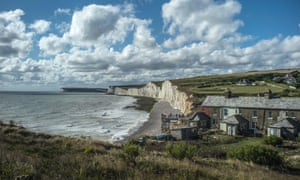 The Seven Sisters country park in East Sussex. The visitor centre at the National Trust's Birling Gap property is designed to be 'rolled back' from the crumbling cliffs.