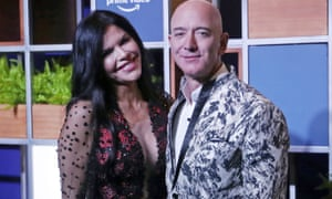 Amazon CEO Jeff Bezos and his girlfriend Lauren Sanchez poses for photographs during a blue carpet event organized by Amazon Prime Video in Mumbai, India, on 16 January.