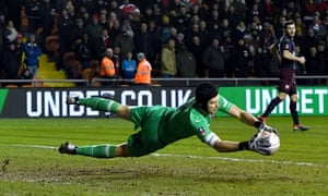 Arsenal goalkeeper Petr Cech saves a shot on goal from Blackpool's Chris Taylor.
