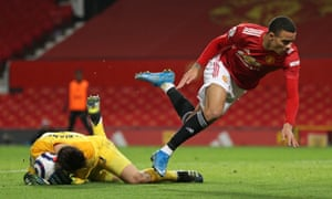 West Ham United's Polish goalkeeper Lukasz Fabianski smothers the ball.