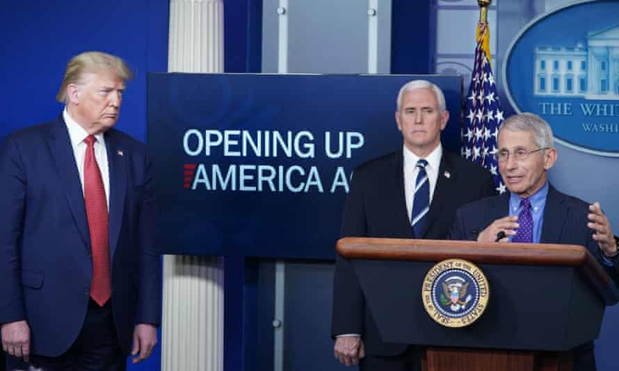 Donald Trump and vice president Mike Pence listen to Anthony Fauci during the Covid-19 daily briefing on 16 April.