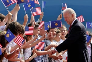 Children cheer and wave flags as Vice-president Joe Biden arrives in Pristina, Kosovo, on 21 May 2009.
