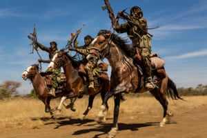 Nature, second prize, stories - Brent StirtonIvory wars: rangers from a horse patrol group exhibit their riding skills as they return to base at Zakouma national park, Chad, after weeks on elephant patrol