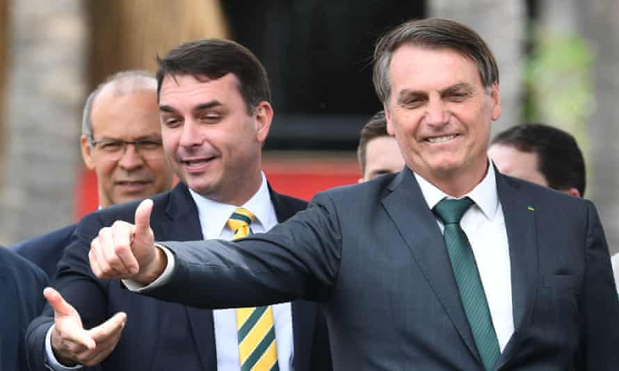 Jair Bolsonaro with his son Flávio. Documents and mobile phones were reportedly seized as 24 warrants were executed in the cities of Rio and Resende.